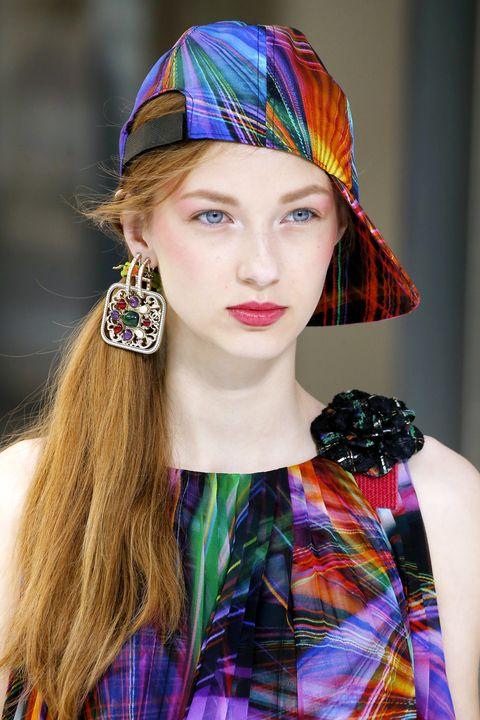 Lip, Textile, Pattern, Plaid, Style, Earrings, Tartan, Headgear, Fashion accessory, Eyelash,