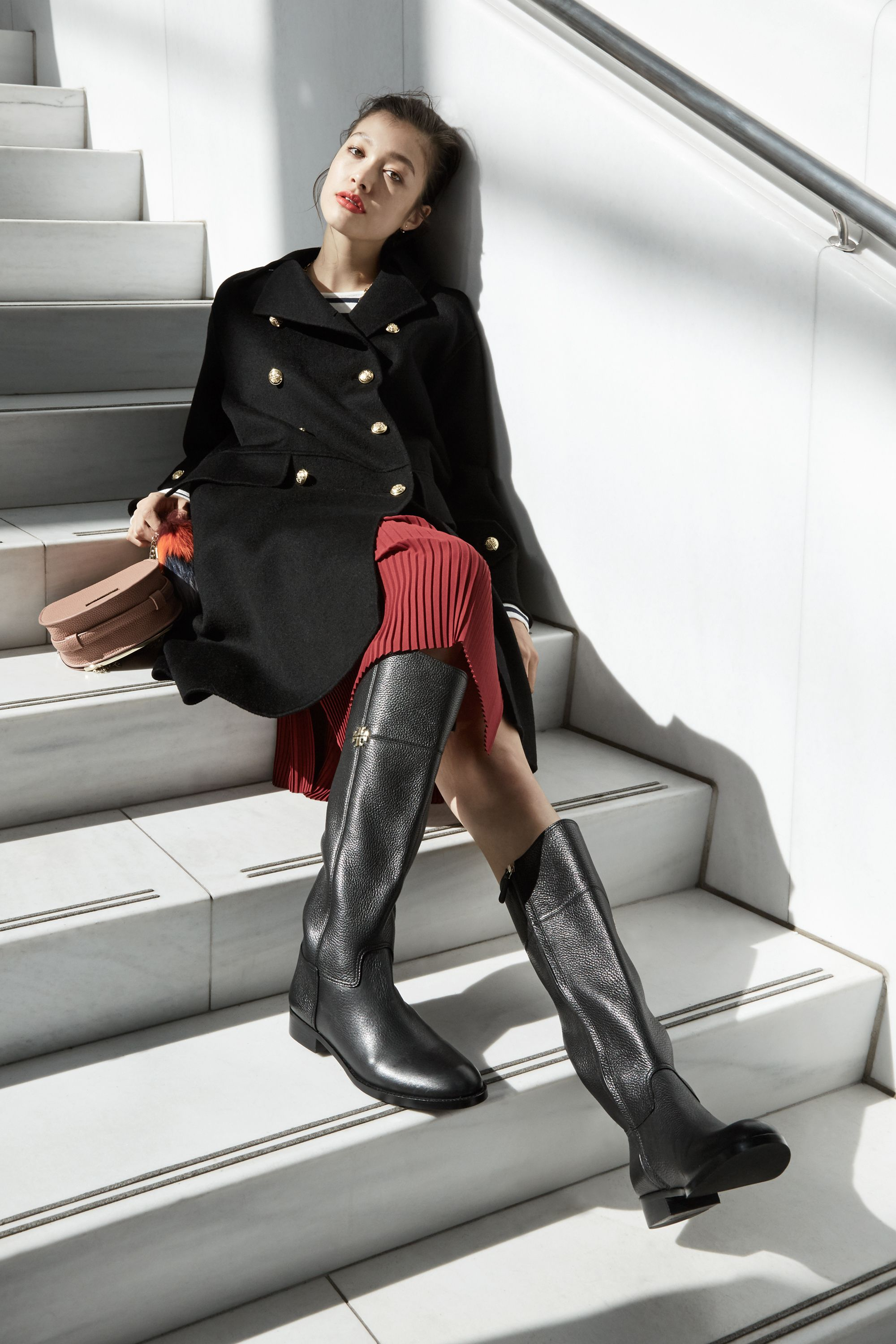 "<p>Knee-high flat boots will be the lynchpin of your autumn daytime wardrobe, looking just as handsome worn with skinny jeans as they will with a chic cashmere midi-skirt. The best part of all? The rich texture will only get better with age and use.<br> </p><p><br> </p><p><em data-redactor-tag=""em""><strong data-redactor-tag=""strong"">The Shoe:</strong> <em data-redactor-tag=""em"">Tory Burch Jolie Riding Boot, $495, <a href=""https://www.toryburch.com/jolie-riding-boot/31192.html?cgid=shoes-boot-%20guide&dwvar_31192_color=001&start=2"" target=""_blank"" data-tracking-id=""recirc-text-link"">toryburch.com</a></em></em> </p><p><br></p><p><em data-redactor-tag=""em""><strong data-redactor-tag=""strong"">The Clothes</strong>: H&M Wool-Blend Coat (similar), $129, <a href=""http://www.hm.com/us/product/56112?article=56112-A"" target=""_blank"" data-tracking-id=""recirc-text-link"">hm.com</a>; J. Crew Deck-Striped T-Shirt, $40, <a href=""https://www.jcrew.com/womens_category/Tshirtsandtanktops/longsleevetshirts/PRDOVR~E1143/E1143.jsp"" target=""_blank"" data-tracking-id=""recirc-text-link"">jcrew.com</a>; & Other Stories Pleats Panel Skirt, $85, <a href=""http://www.stories.com/us/Ready-to-wear/Skirts/Pleats_Panel_Skirt/590576-103649541.1"" target=""_blank"" data-tracking-id=""recirc-text-link"">stories.com</a>; BCBGeneration Lizard-Embossed Saddle Bag, $58, <a href=""http://www.bcbgeneration.com/TPN671GN-280.html?dwvar_TPN671GN-280_color=280#start=13"" target=""_blank"" data-tracking-id=""recirc-text-link"">bcbgeneration.com</a>; Fossil Fur Tail Bag Charm, $38, <a href=""https://www.fossil.com/us/en/products/fur-tail-bag-charm-sku-sl7076788c.html"" target=""_blank"" data-tracking-id=""recirc-text-link"">fossil.com</a></em></p>"