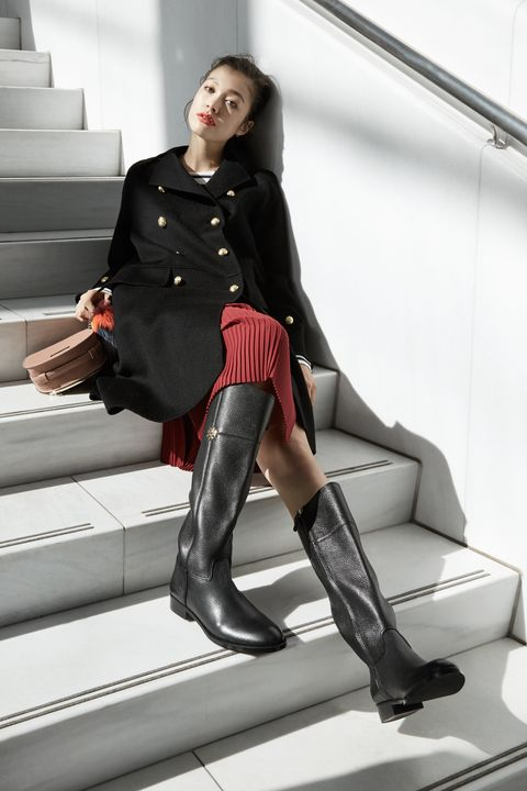 """<p>Knee-high flat boots will be the lynchpin of your autumn daytime wardrobe, looking just as handsome worn with skinny jeans as they will with a chic cashmere midi-skirt. The best part of all? The rich texture will only get better with age and use.<br> </p><p><br> </p><p><em data-redactor-tag=""""em""""><strong data-redactor-tag=""""strong"""">The Shoe:</strong> <em data-redactor-tag=""""em"""">Tory Burch Jolie Riding Boot, $495, <a href=""""https://www.toryburch.com/jolie-riding-boot/31192.html?cgid=shoes-boot-%20guide&amp;dwvar_31192_color=001&amp;start=2"""" target=""""_blank"""" data-tracking-id=""""recirc-text-link"""">toryburch.com</a></em></em> </p><p><br></p><p><em data-redactor-tag=""""em""""><strong data-redactor-tag=""""strong"""">The Clothes</strong>: H&amp;M Wool-Blend Coat (similar), $129, <a href=""""http://www.hm.com/us/product/56112?article=56112-A"""" target=""""_blank"""" data-tracking-id=""""recirc-text-link"""">hm.com</a>; J. Crew Deck-Striped T-Shirt, $40, <a href=""""https://www.jcrew.com/womens_category/Tshirtsandtanktops/longsleevetshirts/PRDOVR~E1143/E1143.jsp"""" target=""""_blank"""" data-tracking-id=""""recirc-text-link"""">jcrew.com</a>; &amp; Other Stories Pleats Panel Skirt, $85, <a href=""""http://www.stories.com/us/Ready-to-wear/Skirts/Pleats_Panel_Skirt/590576-103649541.1"""" target=""""_blank"""" data-tracking-id=""""recirc-text-link"""">stories.com</a>; BCBGeneration Lizard-Embossed Saddle Bag, $58, <a href=""""http://www.bcbgeneration.com/TPN671GN-280.html?dwvar_TPN671GN-280_color=280#start=13"""" target=""""_blank"""" data-tracking-id=""""recirc-text-link"""">bcbgeneration.com</a>; Fossil Fur Tail Bag Charm, $38, <a href=""""https://www.fossil.com/us/en/products/fur-tail-bag-charm-sku-sl7076788c.html"""" target=""""_blank"""" data-tracking-id=""""recirc-text-link"""">fossil.com</a></em></p>"""