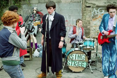 "<p>The plot of Irish musical comedy <em data-redactor-tag=""em"" data-verified=""redactor"">Sing Street</em> is simple: In 1985, Dublin teenager Conor (Ferdia Walsh-Peelo) starts a rock band in hopes of impressing his crush and escaping his unenviable family life. For feelgood, bighearted movies, this teen story can't be beat. <em data-redactor-tag=""em"" data-verified=""redactor"">Sing Street</em><span class=""redactor-invisible-space"" data-verified=""redactor"" data-redactor-tag=""span"" data-redactor-class=""redactor-invisible-space""> is full of optimism</span>, always a welcome presence these days, and the songs are seriously memorable. Director John Carney also made the similarly buoyant flicks <em data-redactor-tag=""em"" data-verified=""redactor"">Begin Again</em> and <em data-redactor-tag=""em"" data-verified=""redactor"">Once</em>. Even if you're not usually a ""musicals person,"" give it a shot. You might be pleasantly surprised. </p>"