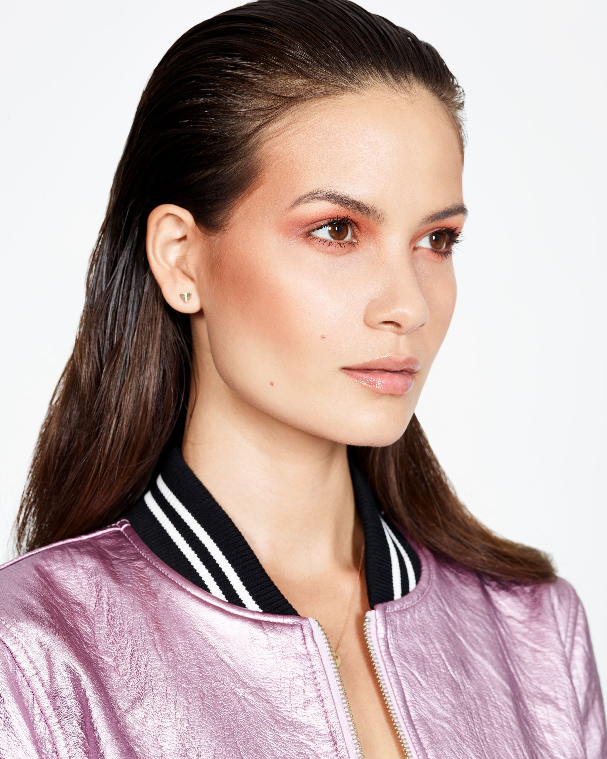 "<p>Lledo re-created this high-impact look by prepping the entire eyelid with a primer (like <a href=""http://www.ulta.com/stay-dont-stray-eyeshadow-primer?productId=xlsImpprod1840041"" target=""_blank"" data-tracking-id=""recirc-text-link"">Nars Smudge Proof Eyeshadow Base</a>, $26) then pressing a translucent burnt orange shadow (try <a href=""http://www1.macys.com/shop/product/mac-eye-shadow-0.05-oz?ID=106344"" target=""_blank"" data-tracking-id=""recirc-text-link"">MAC's Red Brick</a>, $16) into the top crease and along the lower lashes.</p><p>To keep the look wearable for day, Lledo suggests starting with just a small amount of shadow. ""Build the color until you get the intensity you want, then blend the edges,"" he advises. Finish with black mascara on the top and bottom lashes to make the whites of the eye pop.</p>"