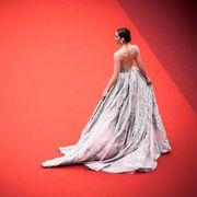Waist, Gown, Fashion model, Abdomen, Arecales, Trunk, Peach, Model, One-piece garment, Haute couture,