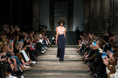 Footwear, Crowd, Fashion, Audience, Fashion show, Runway, Fashion design, Fashion model,