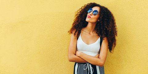 Eyewear, Vision care, Lip, Hairstyle, Jheri curl, Shoulder, Style, Ringlet, Black hair, Jewellery,