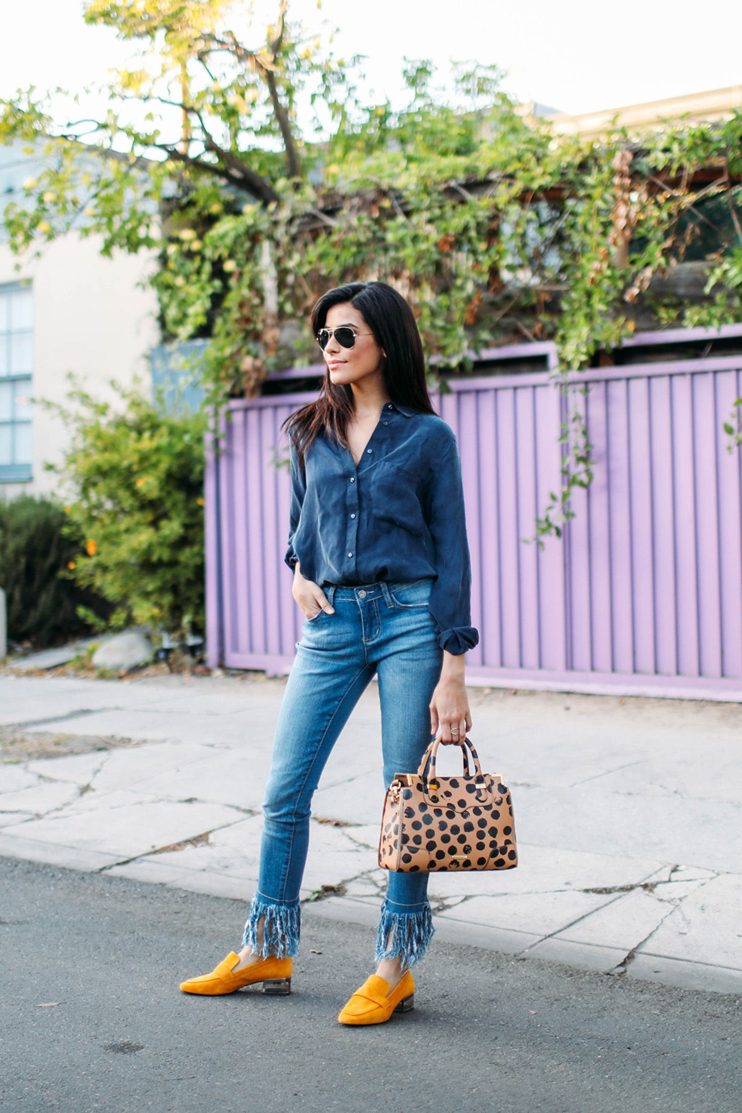 "<p>""This is my typical, everyday look in the office: comfy shoes, denim, and a loose blouse. It's perfect for any occasion and looks timeless. Also, the fringe of the denim and the bright yellow loafers give this look a little extra pizzazz.""</p>  <p><em data-redactor-tag=""em"" data-verified=""redactor"">What she's wearing: Zara blouse, Earl jeans, Topshop yellow loafers</em></p>"