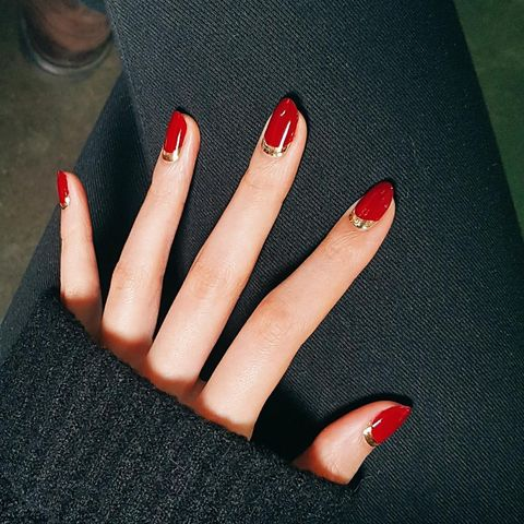<p>Make a red nail instantly glamorous with a metallic accent. Start with - 19 Easy Red Nail Designs - Cute Nail Art Ideas For A Red Manicure