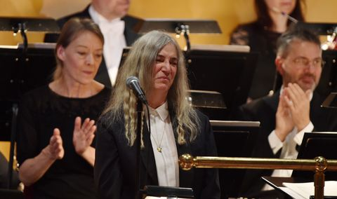 Face, Musical ensemble, Hearing, Classical music, Band plays, Orchestra, Music stand, Layered hair, Wind instrument,