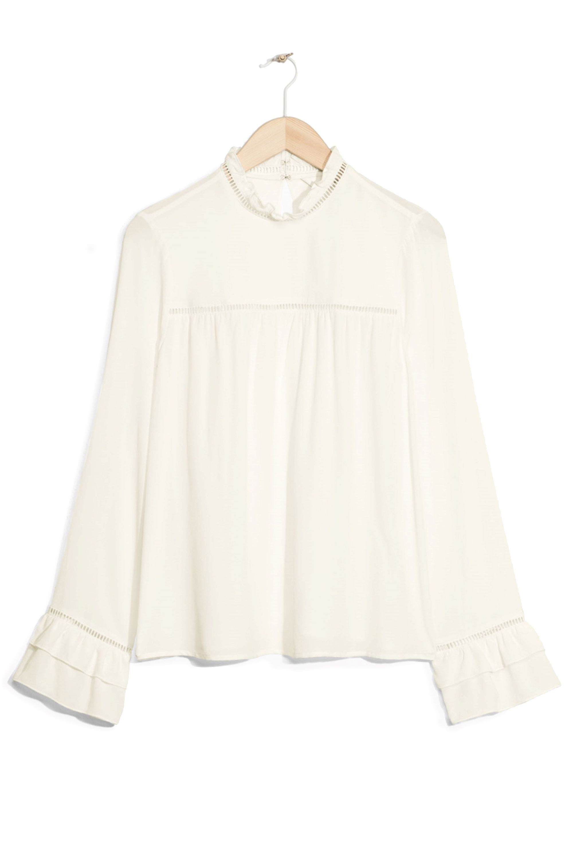 """<p>& Other Stories Frilled Blouse, $65; <a href=""""  http://www.stories.com/us/Ready-to-wear/Tops/Frilled_Blouse/582942-104541390.1"""" data-tracking-id=""""recirc-text-link"""">stories.com</a></p>"""