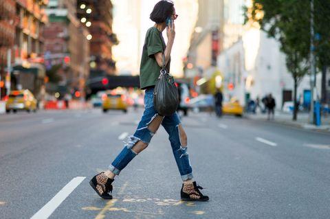 Clothing, Road, Inline skating, Human leg, Infrastructure, Street, Hat, Asphalt, Roller skates, Outerwear,