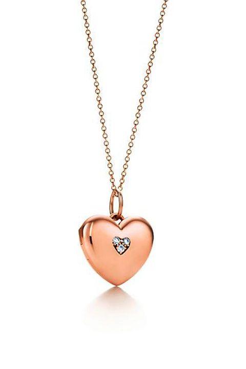 Jewellery, Chain, Pendant, Fashion accessory, Necklace, Locket, Body jewelry, Metal, Tan, Heart,