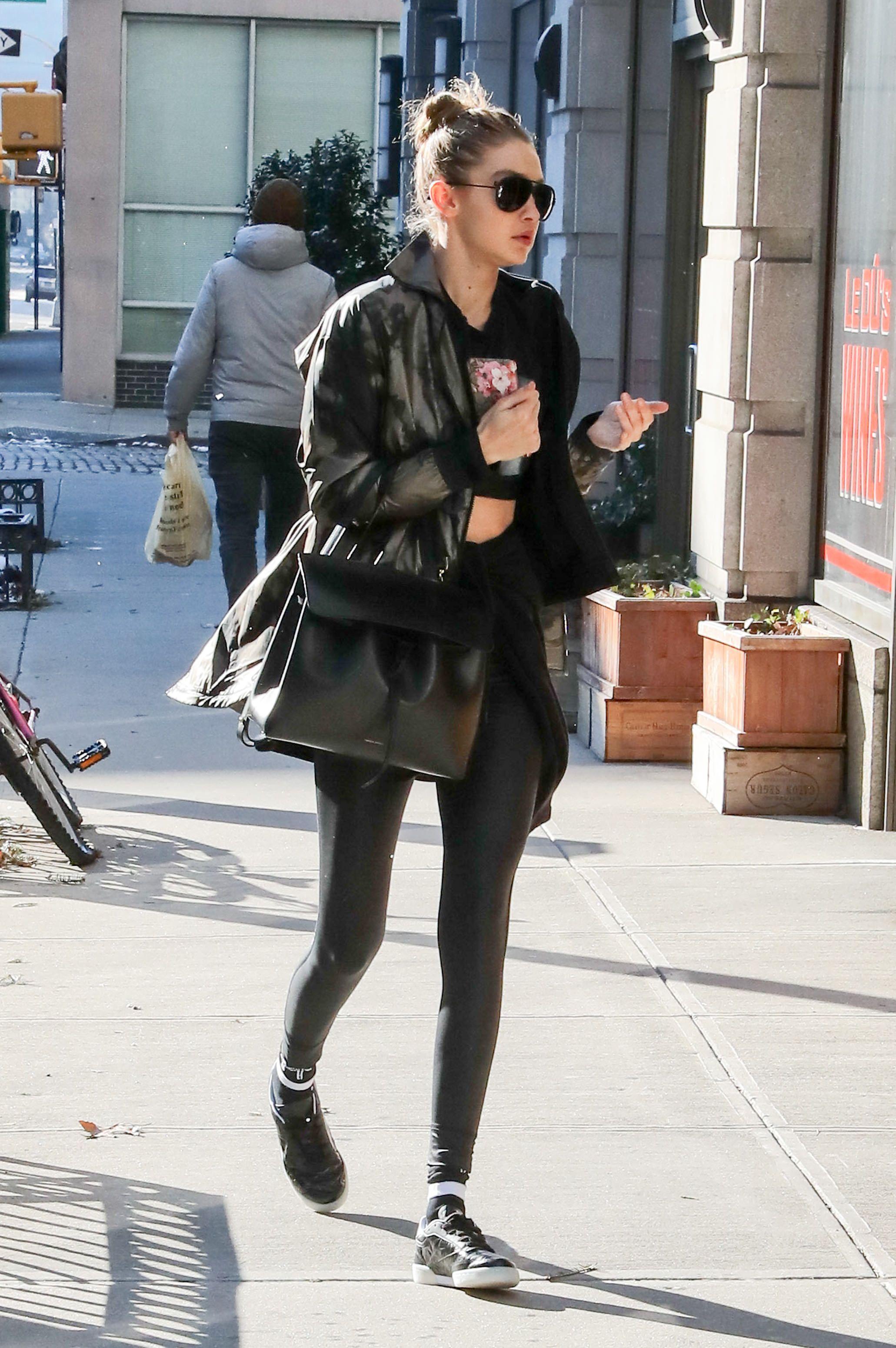 145f99436a Gigi Hadid Wears Giant White Coat to Dinner in NYC - Gigi Hadid Fashion  Photos