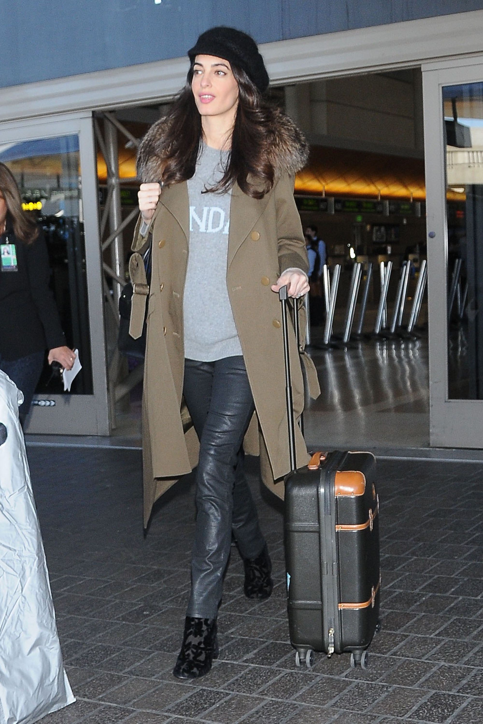 January 27, 2017 Arriving at the airport in an Adam Lippes coat and a slouchy Alberta Ferretti sweater.