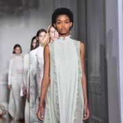 Black hair, Fashion, Fashion design, Exhibition, Visual arts, Art exhibition, Day dress, One-piece garment, Art gallery, Paint,