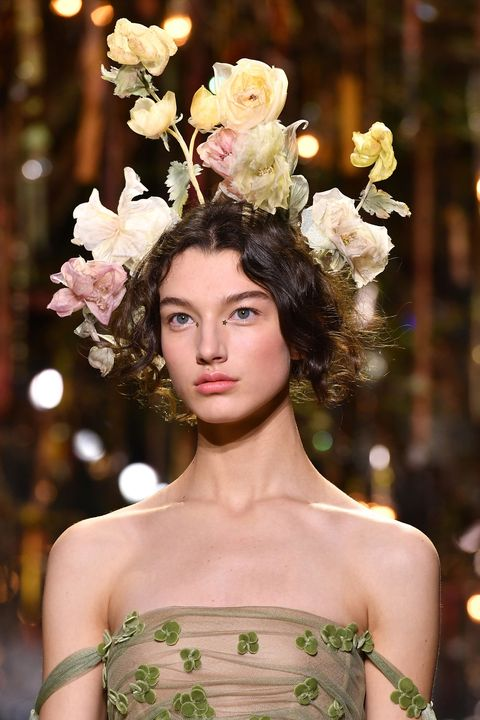 Lip, Hairstyle, Petal, Strapless dress, Style, Eyelash, Beauty, Fashion, Fashion model, Youth,