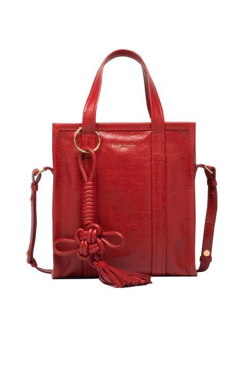 "<p>Balenciaga Chinese New Year Bazar Shopper XS, $1,395;&nbsp;<a href=""http://www.balenciaga.com/us/seasonal-handbag_cod45331270sx.html"" target=""_blank"">balenciaga.com</a></p>"