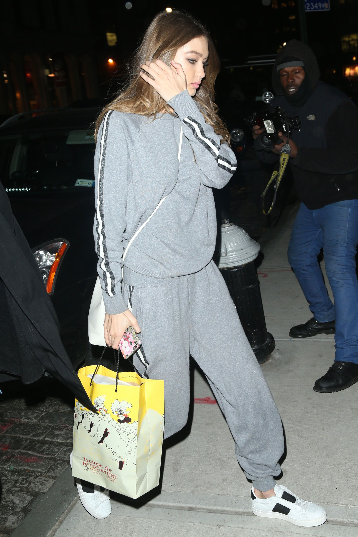 cf47c8b9284 Gigi Hadid Wears Giant White Coat to Dinner in NYC - Gigi Hadid Fashion  Photos