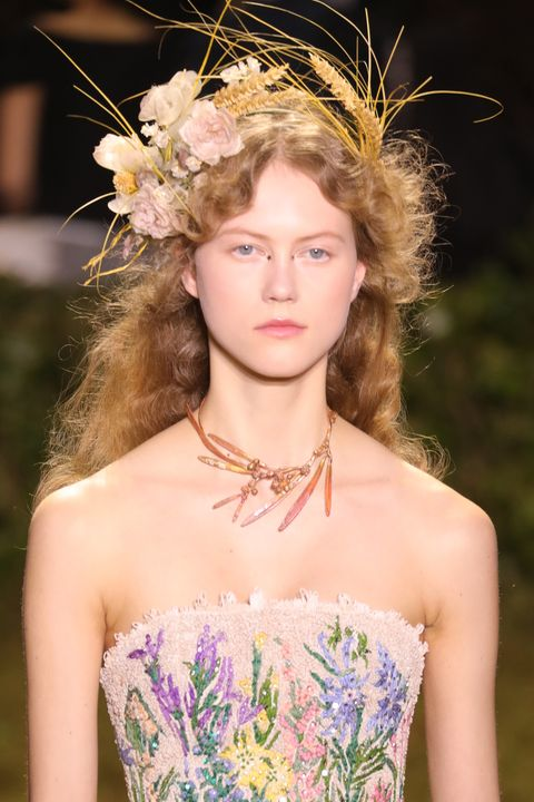 Clothing, Hairstyle, Shoulder, Hair accessory, Headpiece, Strapless dress, Style, Petal, Beauty, Headgear,