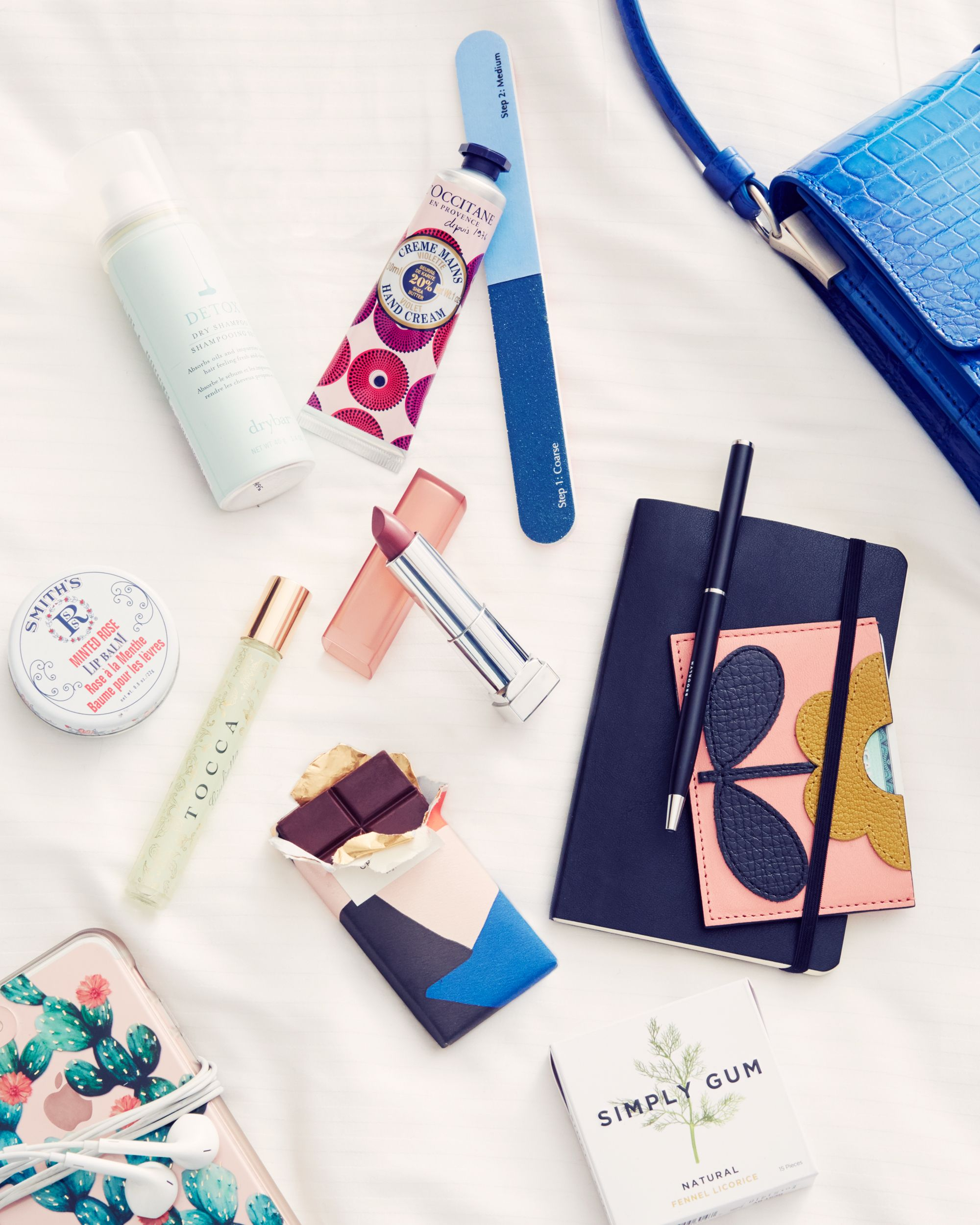 "<p>""What's in my bag? Basically everything I'd need for a long flight. Lip balm, headphones, gum, a nail file, hand cream, dry shampoo (Dry Bar is the best!), and a bar of emergency dark chocolate. Since I'm usually on-the-go I'll opt for a Juice Press smoothie in the mornings—I'm a sucker for them.""</p>"