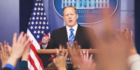 Finger, Microphone, Flag, Hand, Public speaking, Formal wear, Flag of the united states, Tie, Spokesperson, Blazer,