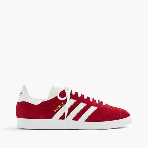 "<p>Adidas, Gazelle Sneakers, $80; <a href=""https://www.jcrew.com/p/F5691?color_name=scarlet"">jcrew.com</a></p>"