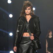 Jacket, Latex, Leather, Fashion, Leather jacket, Black hair, Fashion model, Belt, Goth subculture, Fashion design,