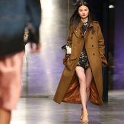 Sleeve, Fashion show, Coat, Outerwear, Style, Street fashion, Fashion model, Runway, Blazer, Waist,