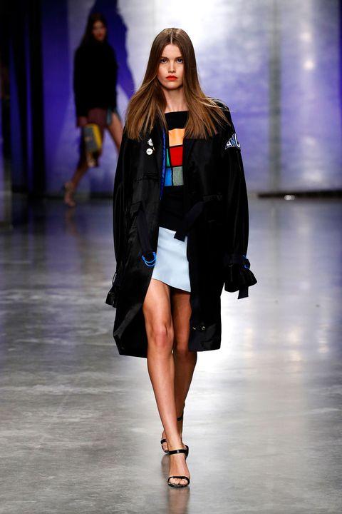 Leg, Fashion show, Human body, Shoulder, Human leg, Runway, Joint, Outerwear, Style, Fashion model,