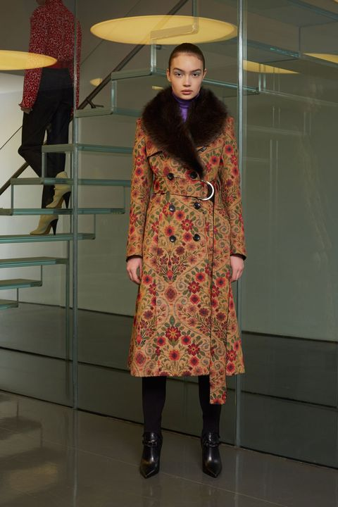Sleeve, Shoe, Overcoat, Street fashion, Fashion, Fur, Costume design, Boot, Fashion model, Fashion design,