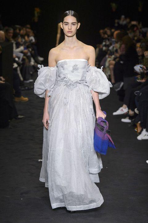 Clothing, Fashion show, Shoulder, Dress, Runway, Fashion model, Style, Gown, One-piece garment, Formal wear,