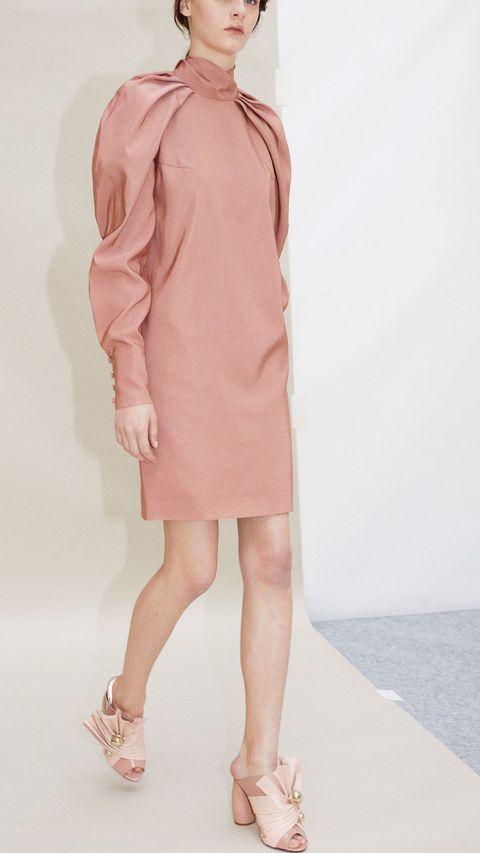 Sleeve, Shoulder, Textile, Human leg, Joint, Collar, Sandal, Toe, Peach, Fashion,