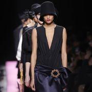 Hat, Shoulder, Fashion show, Fashion accessory, Style, Fashion model, Costume accessory, Runway, Fashion, Black,