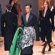 Fashion, Event, Human, Outerwear, Fashion model, Footwear, Fashion design, Dress, Suit, Formal wear,