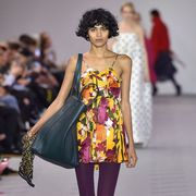 Fashion model, Fashion, Runway, Fashion show, Clothing, Shoulder, Fashion design, Footwear, Haute couture, Black hair,