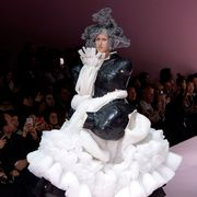 Dress, Costume design, Costume accessory, Fashion, Fashion show, Fashion model, Fur, Gown, Runway, Haute couture,