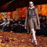 Footwear, Eyewear, Leaf, Deciduous, Fashion show, Sunglasses, Style, Crowd, Street fashion, Runway,