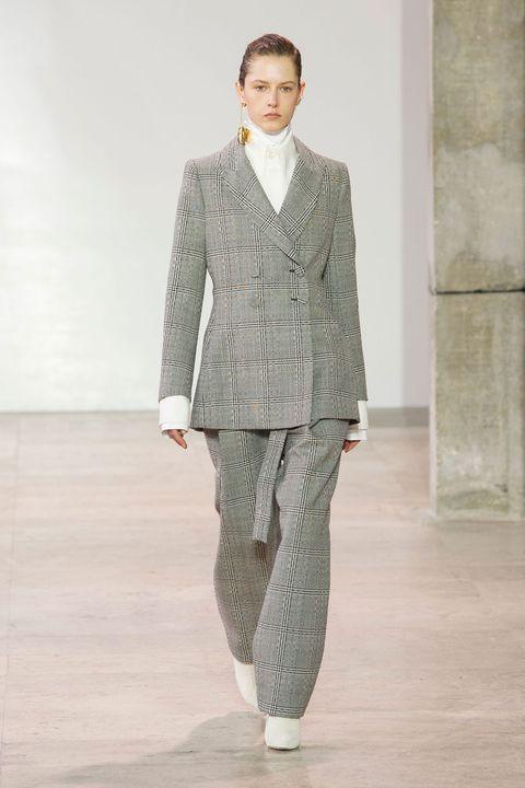 Clothing, Fashion, Suit, Runway, Fashion show, Outerwear, Fashion model, Pantsuit, Human, Formal wear,
