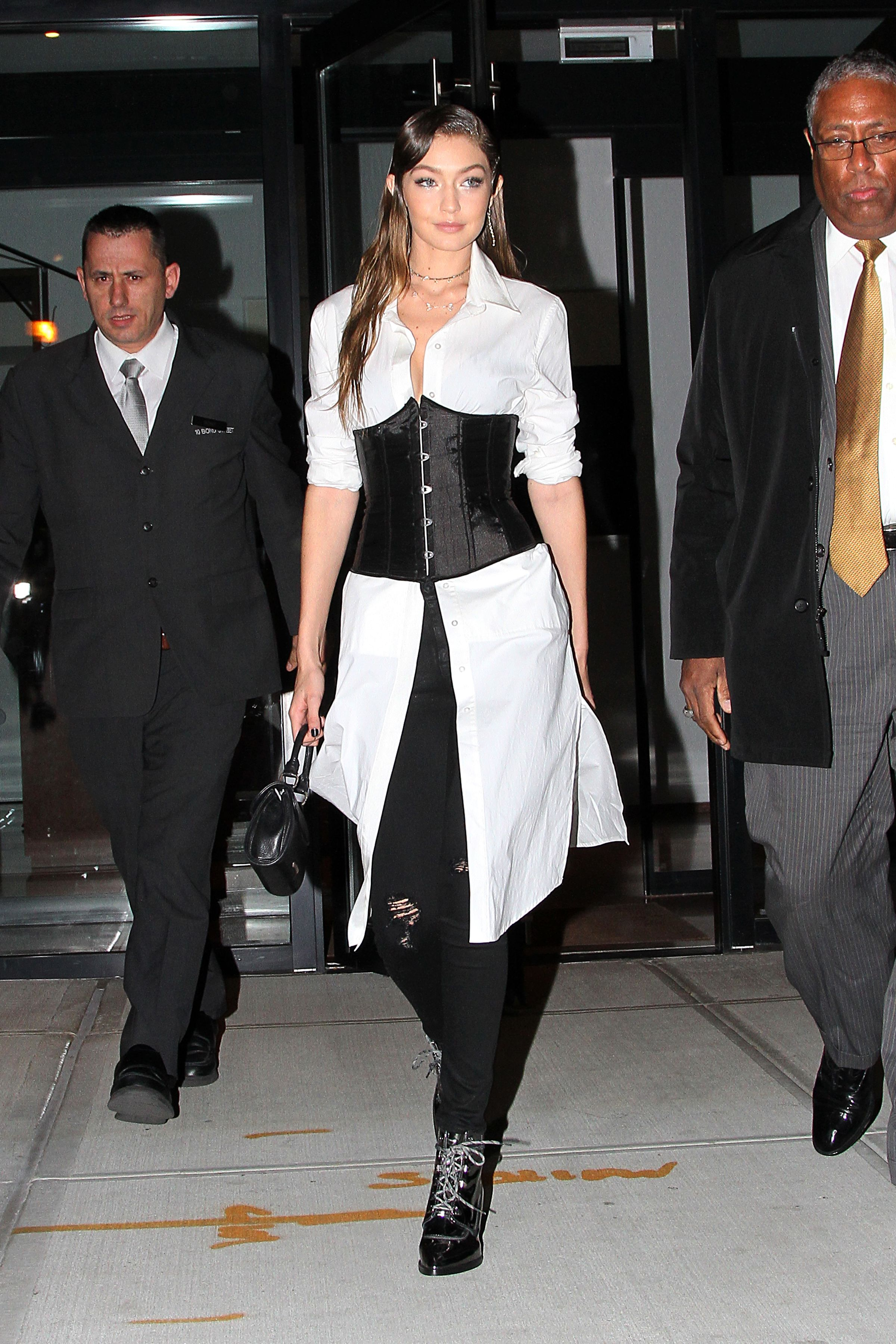 <p>Offset the fitted structure of a full-on satin corset by layering it over a flowy white button-down as seenon Gigi Hadid.</p>