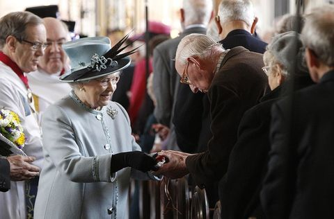 <p>Handing out money at the Derby Cathedral in Derby, United Kingdom.</p>