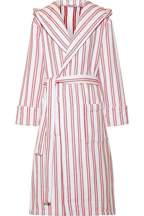 """<p>Take your favorite duster jacket into the summer by leaving it open over a swimsuit.&nbsp;</p><p><strong data-redactor-tag=""""strong"""" data-verified=""""redactor"""">Balenciaga</strong> robe coat, $545, <a href=""""https://www.net-a-porter.com/us/en/product/906773/Balenciaga/hooded-belted-striped-cotton-coat"""" target=""""_blank"""" data-tracking-id=""""recirc-text-link"""">net-a-porter.com</a>.&nbsp;</p>"""