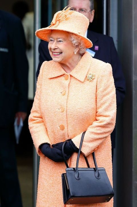 "<p>Her handbag is more often than not <a href=""http://www.townandcountrymag.com/society/tradition/a9750/inside-queen-elizabeths-purse/"" target=""_blank"">the main communication tool she uses to reach her staff</a>.</p>"