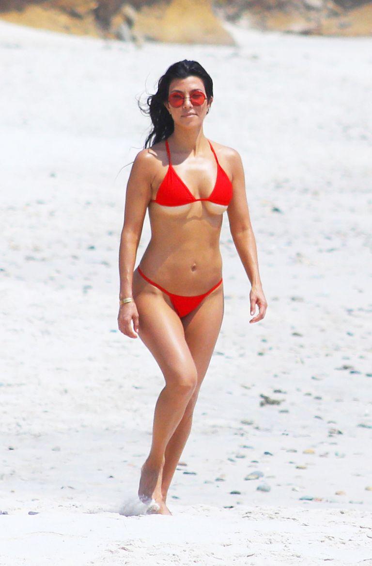 kourtney kardashian takes her underboob to the beach