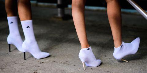 White, Footwear, Human leg, Leg, High heels, Shoe, Calf, Ankle, Joint, Foot,