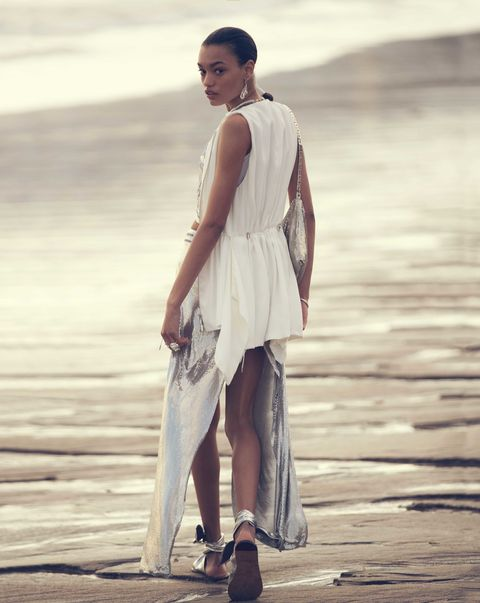 White, Beauty, Standing, Fashion, Dress, Street fashion, Fashion design, Fashion model, Shoulder, Human,
