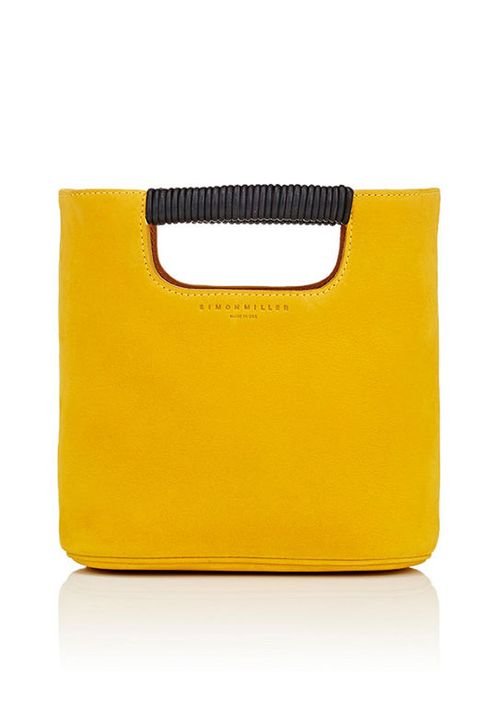 "<p>Trend-driven accessories are best done small. Carry your yellow to off-duty events this season.</p><p><em data-redactor-tag=""em"" data-verified=""redactor"">Simon Miller Birch Mini Tote Bag, $435; </em><a href=""http://www.barneys.com/product/simon-miller-birch-mini-tote-bag-505014841.html"" target=""_blank"" data-tracking-id=""recirc-text-link""><em data-redactor-tag=""em"" data-verified=""redactor"">barneys.com</em></a></p>"