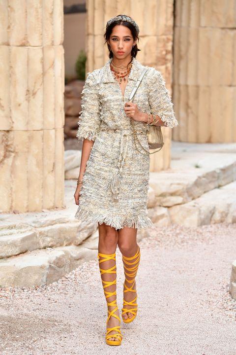 Fashion model, Clothing, Street fashion, Fashion, Yellow, Footwear, Dress, Boot, Knee, Beige,