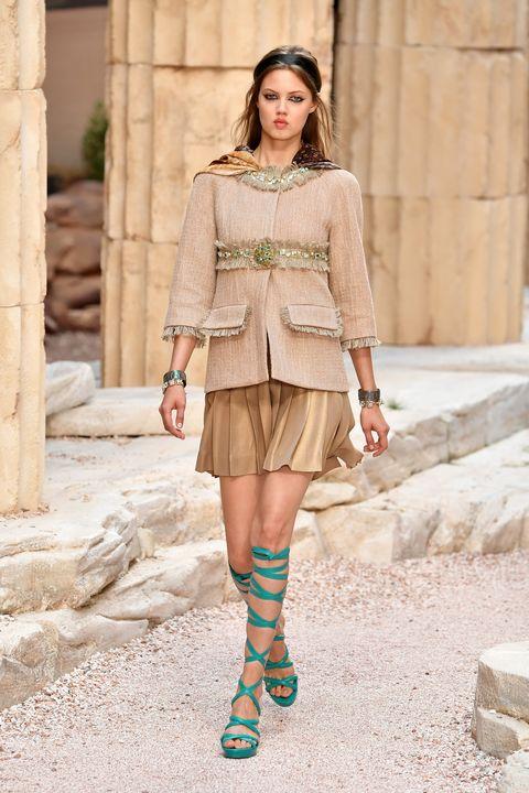 Clothing, Fashion model, Street fashion, Fashion, Shoulder, Yellow, Dress, Beige, Footwear, Tights,