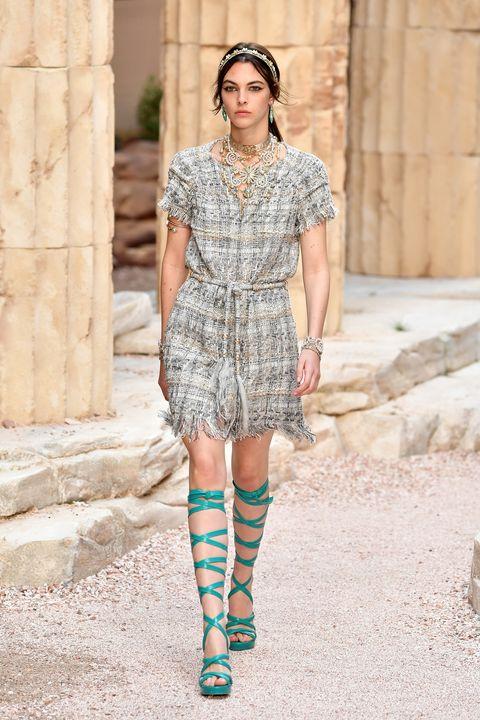 Fashion model, Fashion, Clothing, Street fashion, Shoulder, Footwear, Fashion show, Fashion design, Turquoise, Joint,