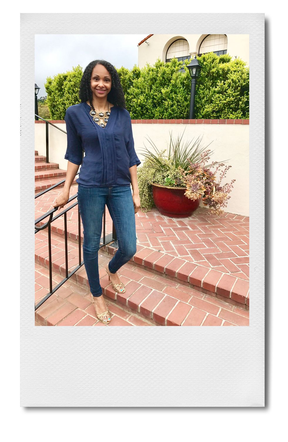 """Bari A. Williams, Head of Operations at StubHub """"There's a famous saying about the surprising temperature of summers in San Francisco: 'The coldest winter I ever spent was a summer in San Francisco.' It's true! Summer averages around 68 degrees and offices are blasting AC inside, which still calls for lightweight denim and a light blouse. This is totally desk to date. Tech is casual, so anything more than this and I'd look out of place. I like to use accessories to dress an outfit up or down, for a presentation, or to meet my husband after work for a date night."""""""