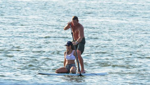 SHELTER ISLAND, NY - JULY 27:  (EXCLUSIVE COVERAGE) Bethenny Frankel  and Michael Cerussi III paddleboard on July 27, 2014 in Shelter Island, New York.  (Photo by James Devaney/GC Images)