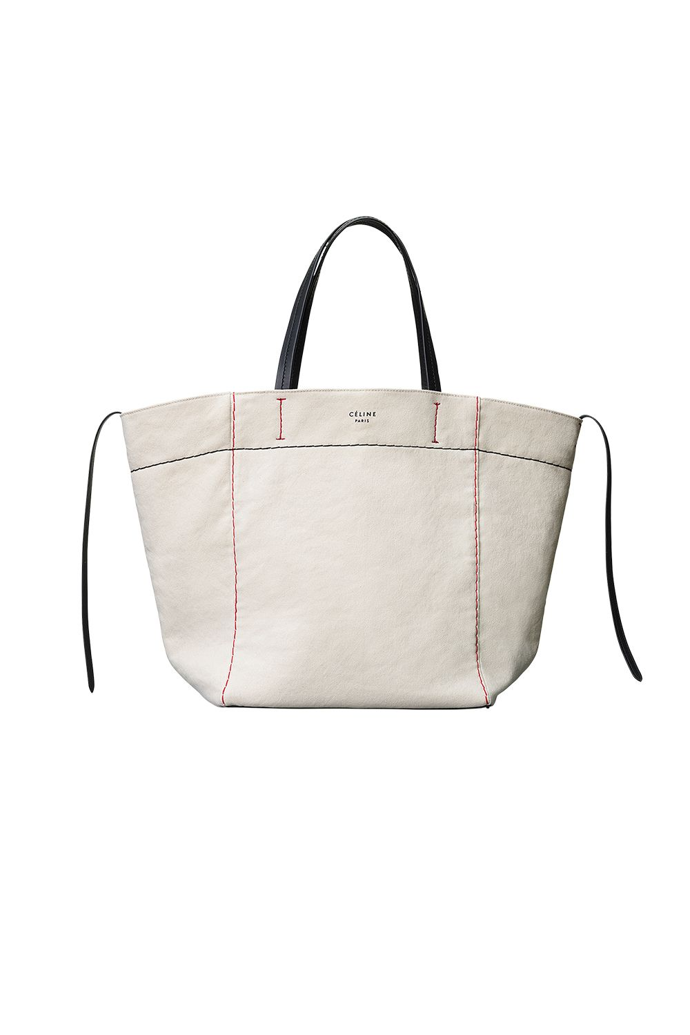 """<p>I love a mini bag, but this perfectly minimal tote holds a few moreessentials.</p><p><em data-redactor-tag=""""em"""" data-verified=""""redactor"""">Canvas tote, CÉLINE,</em><em data-redactor-tag=""""em"""" data-verified=""""redactor"""">at Céline, NYC</em><span data-redactor-tag=""""span""""></span></p>"""